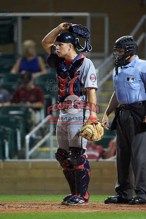 Scottsdale Scorpions catcher Stuart Turner (11) and umpire Carlos Torres during an Arizona Fall League game against the Salt River Rafters on October 13, 2015 at Salt River Fields at Talking Stick in Scottsdale, Arizona.  Salt River defeated Scottsdale 5-3.  (Mike Janes/Four Seam Images)
