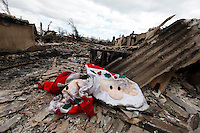 Damage caused by Hurricane Sandy, Breezy Point, Queens, NY, five days after the hurricane hit.  More than 100 homes were burned to the ground and many others damaged by a 6 alarm fire the night of the hurricane.  Miraculously, this Santa Claus decoration survived the blaze..Breezy Point is a beachfront neighborhood located on the western end of the Rockaway peninsula, between Rockaway Inlet and Jamaica Bay on the landward side, and the Atlantic Ocean.