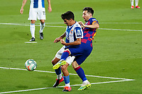 8th July 2020; Camp Nou, Barcelona, Catalonia, Spain; La Liga Football, Barcelona versus Espanyol; Leo Messi is held off the ball by Gómez of Espanyol