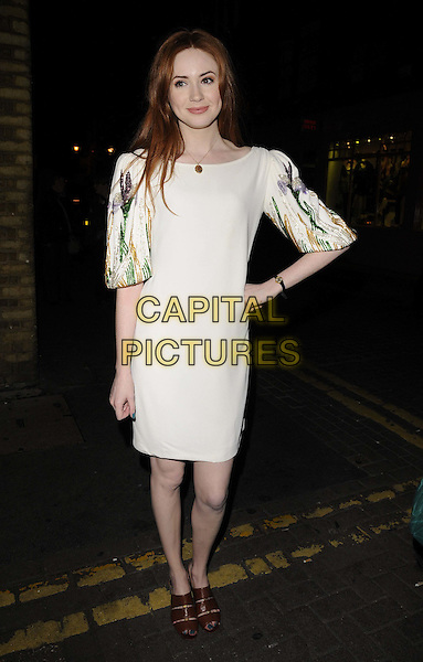 "Karen Gillan .departed after the press night performance in ""Inadmissible Evidence"", Donmar Warehouse theatre, Earlham St., London, England..October 18th, 2011.full length white dress print sleeves brown sandals hand on hip.CAP/CAN.©Can Nguyen/Capital Pictures."