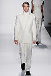 Model walks runway an MEN'S IVORY ITALIAN SILK DUPIONI D/B SUIT W/ HAND TOP STITCHING AND  MEN'S IVORY ITALIAN SILK DUPIONI DRESS SHIRT W/BOW TIE by Zang Toi, for the Zang Toi Spring 2012 My Dream Of North Africa Collection, during Mercedes-Benz Fashion Week Spring 2012.