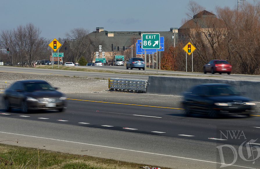 NWA Democrat-Gazette/BEN GOFF @NWABENGOFF<br /> Cars drive along I-49 on Sunday Dec. 6, 2015 at Exit 86 in Bentonville. Cable safety barriers are being replaced with concrete barriers in many areas as part of widening the highway.