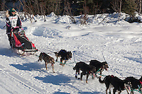 Musher Zoya DeNure on Long Lake at the Re-Start of the 2011 Iditarod Sled Dog Race in Willow, Alaska.