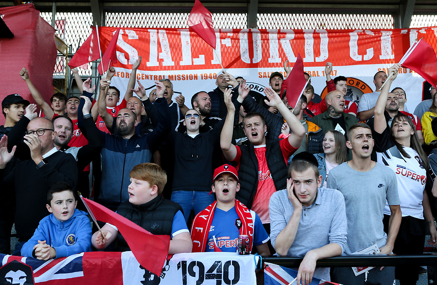 Salford City fans in fine voice<br /> <br /> Photographer Alex Dodd/CameraSport<br /> <br /> The Carabao Cup First Round - Salford City v Leeds United - Tuesday 13th August 2019 - Moor Lane - Salford<br />  <br /> World Copyright © 2019 CameraSport. All rights reserved. 43 Linden Ave. Countesthorpe. Leicester. England. LE8 5PG - Tel: +44 (0) 116 277 4147 - admin@camerasport.com - www.camerasport.com