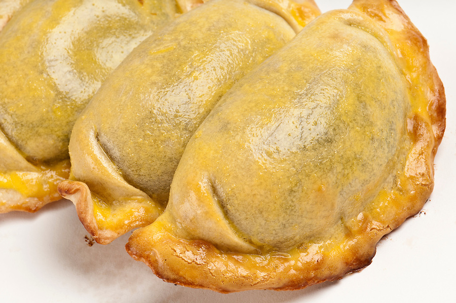 Group of Latin american empanadas. The Empanada is a pastry turnover filled with a variety of savory ingredients and baked or fried.