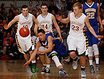 RAPID CITY, S.D. MARCH 20, 2015 -- Shilo Tallman #24 of Little Wound chases a loose ball trailed by Jayden Everson #10, Landon Hoellein #34 and Brayden McNeary #23 of Aberdeen Roncalli during their semi-final game at the 2015 South Dakota State A Boys Basketball Tournament at the Don Barnett Arena in Rapid City, S.D.  (Photo by Dick Carlson/Inertia)