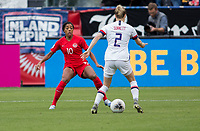 CARSON, CA - FEBRUARY 9: Ashley Lawerance #10 of Canada defends against advancing Emily Sonnett #2 of USA during a game between Canada and USWNT at Dignity Health Sports Park on February 9, 2020 in Carson, California.