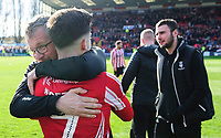 Lincoln City kit manager Terry Bourne hugs Lincoln City's Tom Pett as they celebrate securing promotion from Sky Bet League Two<br /> <br /> Photographer Chris Vaughan/CameraSport<br /> <br /> The EFL Sky Bet League Two - Lincoln City v Cheltenham Town - Saturday 13th April 2019 - Sincil Bank - Lincoln<br /> <br /> World Copyright © 2019 CameraSport. All rights reserved. 43 Linden Ave. Countesthorpe. Leicester. England. LE8 5PG - Tel: +44 (0) 116 277 4147 - admin@camerasport.com - www.camerasport.com