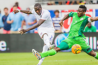 June 07, 2014:   the United States of America forward Jozy Altidore (17) scores his second goal of the game while being defended by Nigeria defender Joseph Yobo (2) during action between the USA Men's National Soccer team and Nigeria at EverBank Field in Jacksonville, Florida.  This is the last match before the USA team leaves for Brazil and the 2014 World Cup Championships. USA defeated Nigeria 2-1.