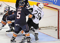 San Antonio Rampage's Bill Thomas (29) watches the puck sail into the net past Oklahoma City Barons goaltender Yann Danis, left, and Barons' Dylan Yeo (5) during the second period of an AHL hockey game, Friday, May 11, 2012, in San Antonio. (Darren Abate/pressphotointl.com)