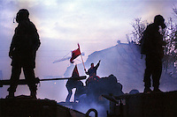 KOSOVO. Mitrovice. 21/02/2000..British troops stand guard as Albanians demonstrate against the Serbs in the North of the city. Rioting broke out after a 60,000 strong demonstration tried to storm the bridge separating the two communities..©Andrew Testa