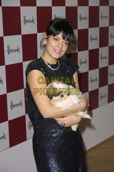 LILY ALLEN.opening The Harrods Winter Sale..Knightsbridge, London, England..28th December 2007.half length black dress holding puppy dog.CAP/CAN.©Can Nguyen/Capital Pictures