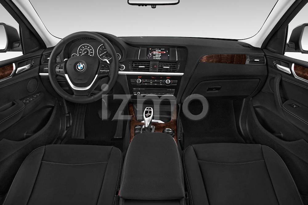 Stock photo of straight dashboard view of 2017 BMW X4 xDrive28i 5 Door SUV Dashboard