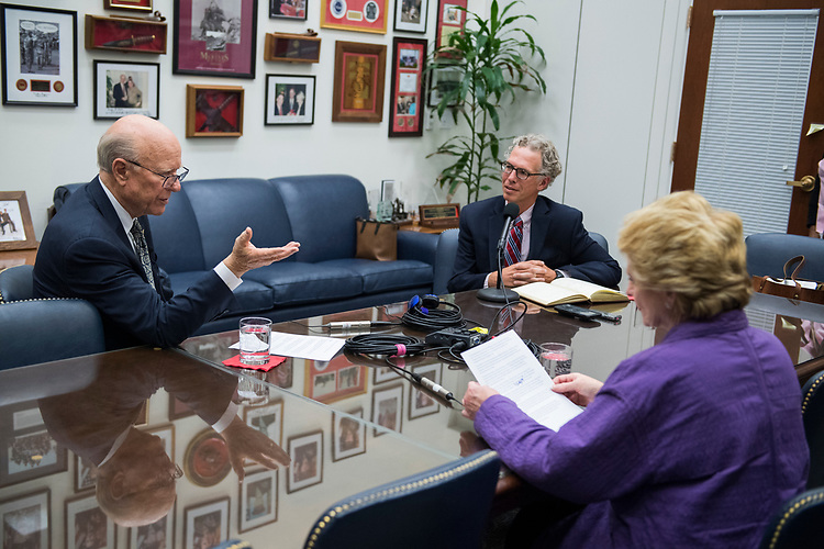 UNITED STATES - JULY 12: Senate Agriculture Committee Chairman Pat Roberts, R-Kan., left, and ranking member Sen. Debbie Stabenow, D-Mich., prepare for a podcast with CQ editor Shawn Zeller, center, in Hart Building on July 12, 2018. (Photo By Tom Williams/CQ Roll Call)