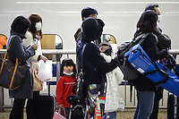 Families taking the bullet train west amidst worries about radiation in Tokyo, Tokyo station, Tokyo, Japan, March 15, 2011.