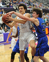 NWA Democrat-Gazette/ANDY SHUPE<br /> Fayetteville wing Bradon Simon (22) collects a rebound as Rogers wing Garrett Dake reaches to defend Friday, Feb. 10, 2017, during the first half of play in Bulldog Arena. Visit nwadg.com/photos to see more photographs from the game.