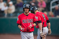 Billings Mustangs shortstop Carlos Rivero (23) walks towards the dugout after scoring a run during a Pioneer League game against the Idaho Falls Chukars at Melaleuca Field on August 22, 2018 in Idaho Falls, Idaho. The Idaho Falls Chukars defeated the Billings Mustangs by a score of 5-3. (Zachary Lucy/Four Seam Images)