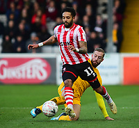 Lincoln City's Bruno Andrade vies for possession with Northampton Town's Kevin van Veen<br /> <br /> Photographer Andrew Vaughan/CameraSport<br /> <br /> Emirates FA Cup First Round - Lincoln City v Northampton Town - Saturday 10th November 2018 - Sincil Bank - Lincoln<br />  <br /> World Copyright © 2018 CameraSport. All rights reserved. 43 Linden Ave. Countesthorpe. Leicester. England. LE8 5PG - Tel: +44 (0) 116 277 4147 - admin@camerasport.com - www.camerasport.com