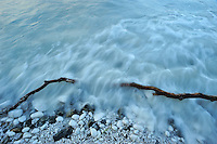 Wave on driftwood and chalk stones - Møns Klint, Denmark