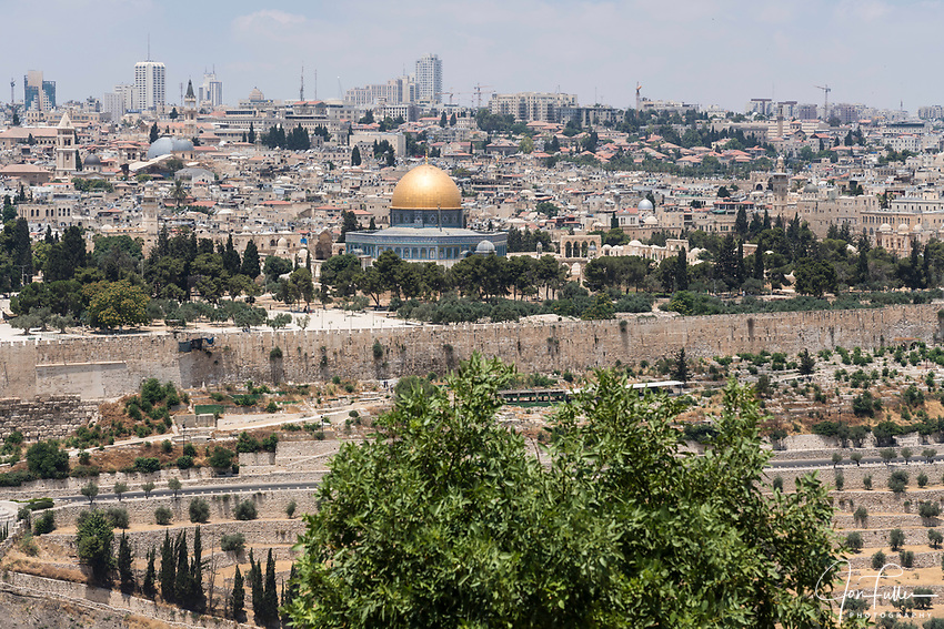 The Dome of the Rock shrine on the Temple Mount or al-Haram ash-Sharif in the Old City of Jerusalem, across the Kidron Valley as seen from the Mount of Olives.  The Christian Quarter of the Old City is to the left of the dome with the Muslim Quarter to its right.   The Old City of Jerusalem and its Walls is a UNESCO World Heritage Site.