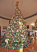 Washington, DC - December 4, 2000 -- The White House Christmas tree in the Blue Room at the White House in Washington, D.C. on December 4, 2000.  By tradition, the Blue Room is the place of honor for the official White House Christmas tree.  For Christmas 2000 an eighteen-foot Douglas fir was presented to The First Family by Paul and Sharon Shealer and their children of Evergreen Acres Tree Farm in Auburn, Pennsylvania.  The Shealers won the honor after being named the National 2000 Grand Champion Grower by the National Christmas Tree Association.  The decorations are a sampling from all the past ornaments from the Clinton years.   The velvet tree skirt at the base has adorned the Blue Room tree since 1993, when it was designed by individuals from each of the fifty states, territories, and the District of Columbia in celebration of the Clinton's first Christmas at the White House..Credit: Ron Sachs - CNP