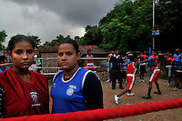 INDIA (West Bengal - Calcutta) August 2010,Shakila Babe(right) and Sanno Babe (left) during practice in a local boxing club. Shakila and Shanno are twins from a poor muslim family of Iqbalpur, Kolkata. . Inspite of their late father's unwillingness to send his daughters to take up  boxing her mother Banno Begum inspired them to take up boxing at the age of 3. Their father was more concerned about the social stigma they have in their community regarding women coming into sports or doing anything which may show disrespect to the religious emotions of his community. Shakila now has been recognised as one of the best young woman boxers of the country after she won the  international championship at Turkey in the junior category. Shanno is also been called for the National camp this year. Presently Shakila and shanno has become the role model in the Iqbalpur area  and parents from muslim community of Iqbalpur have started showing interst in boxing. Iqbalpur is a poor muslim dominated area mostly covered with shanty town with all odds which comes along with poverty and lack of education. - Arindam Mukherjee