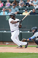 Chris Jacobs (33) of the Winston-Salem Dash follows through on his swing against the Myrtle Beach Pelicans at BB&T Ballpark on April 18, 2015 in Winston-Salem, North Carolina.  The Pelicans defeated the Dash 4-1 in game one of a double-header.  (Brian Westerholt/Four Seam Images)