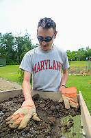 HAZLETON, PA - JUNE 30: Mike Roller works at the site of an archaeologic dig June 30, 2014 in Hazleton, Pennsylvania. The team is looking through sites connected with the Lattimer Massacre which occurred in 1897. (Photo by William Thomas Cain/Cain Images)