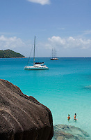Seychelles, Island Praslin, Anse Lazio: sailing ship, catamaran, Anse Lazio Bay, couple snorkeling<br />