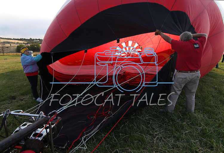 Volunteers help inflate the Wells Fargo balloon at the 30th anniversary of the Great Reno Balloon Race,  in Reno, Nev., on Friday, Sept. 8, 2011..Photo by Cathleen Allison