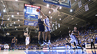 DUKE, NC - FEBRUARY 15: Justin Robinson #50 of Duke University blocks a shot by Elijah Morgan #31 of the University of Notre Dame during a game between Notre Dame and Duke at Cameron Indoor Stadium on February 15, 2020 in Duke, North Carolina.