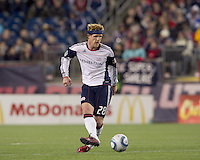 New England Revolution midfielder Pat Phelan (28) passes the ball. In a Major League Soccer (MLS) match, the New England Revolution tied the Portland Timbers, 1-1, at Gillette Stadium on April 2, 2011.