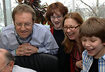 MELVILLE,NY-MONDAY APRIL 16, 2007: Newsday Cartoonist, Walter Handelsman with sons James, age 15, and Billy, age 12, and wife Jodie gathered around James M. Klurfeld, Editor of the Editorial Pages, in the Viewpoints offices of Newsday in Melville on Monday April 16, 2007, to get the official word on Klurfeld's computer that Handelsman has won his 2nd Pulitzer for his Editorial Cartoons. Photo by/Jim Peppler.