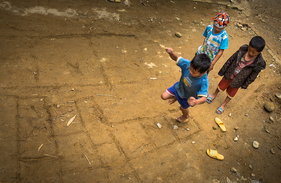SAPA, VIETNAM - CIRCA SEPTEMBER 2014:  Kids playing hopscotch in Ta Phin Village near Sapa, north Vietnam.
