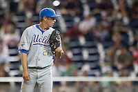 UCLA pitcher David Berg (26) looks to his catcher for the sign during Game 1 of the 2013 Men's College World Series Finals against the Mississippi State Bulldogs on June 24, 2013 at TD Ameritrade Park in Omaha, Nebraska. The Bruins defeated the Bulldogs 3-1, taking a 1-0 lead in the best of 3 series. (Andrew Woolley/Four Seam Images)