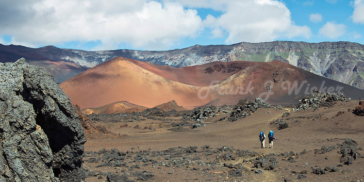 Two hikers with backpacks in the crater of Haleakala National Park on Maui in Hawaii, USA