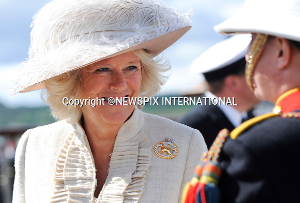 """CAMILLA, DUCHESS OF CORNWALL.HMS ASTUTE COMMISSONING - Duchess of Cornwall Camilla Parker BowlesThe Duchess of Cornwall speaking to a member of the Royal Marine Band Service. The UK's most powerful attack submarine, HMS Astute, has been welcomed into the Royal Navy today.In a Commissioning ceremony overseen by the boat's patron the Duchess of Cornwall, Astute officially became 'Her Majesty's Ship'.HMS Astute is quieter than any of her predecessors, meaning she has the ability to operate covertly and remain undetected in almost all circumstances despite being fifty per cent bigger than any attack submarine in the Royal Navy's current fleet.The latest nuclear powered technology means she will never need to be refuelled and can circumnavigate the world submerged, creating the crew's oxygen from seawater as she sails. The submarine has the capacity to carry a mix of Spearfish heavyweight torpedoes and Tomahawk Land Attack Cruise missiles - and can target enemy submarines, surface ships and land targets with pinpoint accuracy, while her world-beating sonar system is capable of detecting ships and submarines at many hundreds of miles_Helensburgh, Argyll & Bute 27/08/2010..Photo Credit: ©S Hill_Newspix International..**ALL FEES PAYABLE TO: """"NEWSPIX INTERNATIONAL""""**..PHOTO CREDIT MANDATORY!!: NEWSPIX INTERNATIONAL..IMMEDIATE CONFIRMATION OF USAGE REQUIRED:.Newspix International, 31 Chinnery Hill, Bishop's Stortford, ENGLAND CM23 3PS.Tel:+441279 324672  ; Fax: +441279656877.Mobile:  0777568 1153.e-mail: info@newspixinternational.co.uk."""