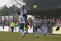 Anthony Straker of Grimsby Town wins a header during the FA Trophy Semi Final first leg match between Bognor Regis and Grimsby Town at Nyewood Lane, Bognor Regis, England on 12 March 2016. Photo by Paul Paxford/PRiME Media Images.