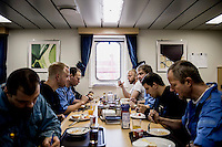 The crew of the Mary Maersk, the largest container ship in the world, eat breakfast.