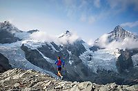 Trail running on a moraine beneath the Weisshorn on the way to the Mettelhorn, above Zermatt, Switzerland.