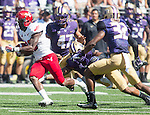 Eastern Washington Eagles' running back Quincy Forte (22) runs against the Washington Huskies at Husky Stadium September 6, 2014 in Seattle. Huskies out lasted the Eagles in a high powered shootout 59-52 in the third highest scoring game in Husky history.  Forte rushed for 69 yards.  ©2014. Jim Bryant  Photo. All Rights Reserved