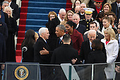 Vice President Mike Pence shakes hands with President Barack Obama after taking the Oath of Office from Justice Clarance Thomas at the inauguration on January 20, 2017 in Washington, D.C.  Donald Trump became the 45th President of the United States.       <br /> Credit: Pat Benic / Pool via CNP