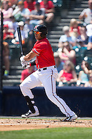 Ricky Oropesa (33) of the Richmond Flying Squirrels follows through on his swing against the Bowie Baysox at The Diamond on May 25, 2015 in Richmond, Virginia.  The Flying Squirrels defeated the Baysox 6-1. (Brian Westerholt/Four Seam Images)