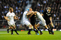 Aaron Cruden of New Zealand is tackled by Ben Morgan (left) and Owen Farrell of England during the QBE Autumn International match between England and New Zealand at Twickenham on Saturday 16th November 2013 (Photo by Rob Munro)