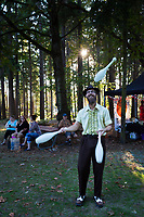 Juggler at Sunset, Arts A Glow Festival, Dottie Harper Park, Burien, Washington State, WA, America, USA.
