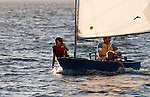 Sailing - Man and two girls in a sailing dinghy