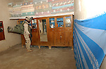Pfc. Charles Barnes, from Saint Louis, Mo., searches a room in a home in Tall Afar, Iraq, during an operation called Sykes Hammer on Aug. 1, 2004. Three battalions from the 3rd Brigade, 2nd Infantry Division (Stryker Brigade Combat Team) and three Iraqi National Guard battalions conducted Sykes Hammer in an effort to seize weapons and detain anti-Iraqi forces. Reese is a member of Company B, 5th Battalion, 20th Infantry Regiment. (U.S. Army photo by Sgt. Fred Minnick)