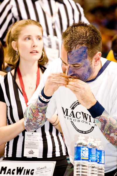 &quot;MacWing&quot; at the 14th annual Wing Bowl, held in Philadelphia on February 3, 2006 at the Wachovia Center.<br /> <br /> The Wing Bowl is a competitive eating event in which eaters try and down the most hot wings in 30 total minutes in front of a crowd of 10,000 plus people.  The real show however is all around the eaters, from the various scantily clad women (known as &quot;Wingettes&quot;) that make up eaters' entourages, to the behavior of the fans themselves.