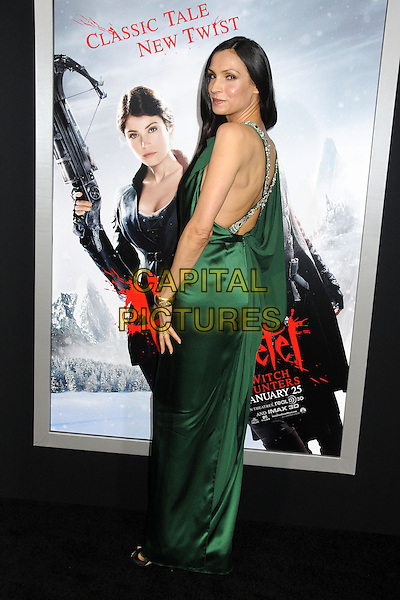 Famke Janssen.attending the Paramount Los Angeles film premiere of 'Hansel and Gretel: Witch Hunters', held at The Grauman's Chinese Theater in Hollywood, California, USA, January 24th 2013..full length green silk satin dress straps cross over back rear behind silver beaded clutch bag looking over shoulder .CAP/ADM/BP.©Byron Purvis/AdMedia/Capital Pictures.