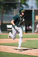 Oakland Athletics outfielder Devin Foyle (31) runs to first base during an Instructional League game against the Los Angeles Dodgers at Camelback Ranch on October 4, 2018 in Glendale, Arizona. (Zachary Lucy/Four Seam Images)